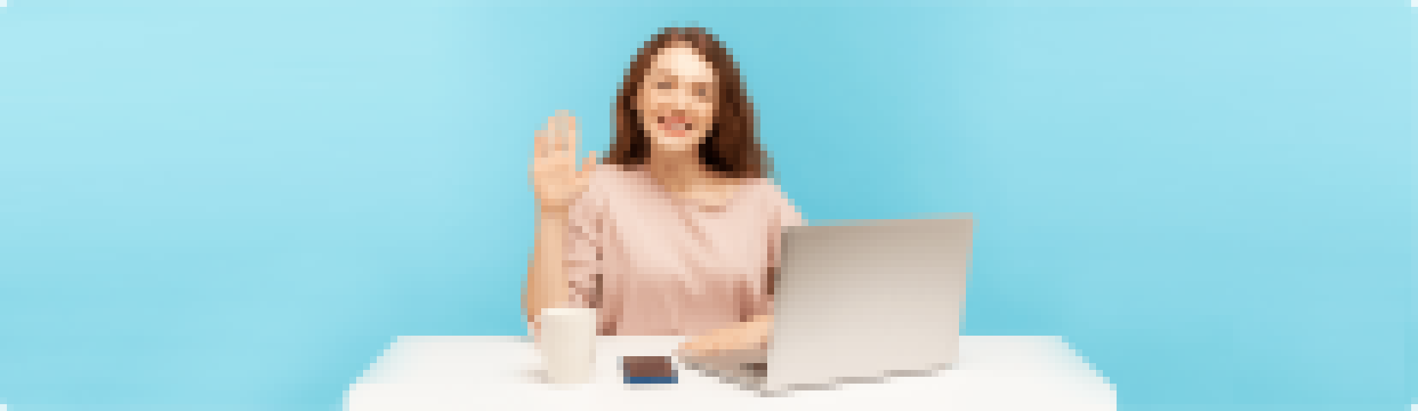 A coding teacher waves at her student in a one-on-one online coding class